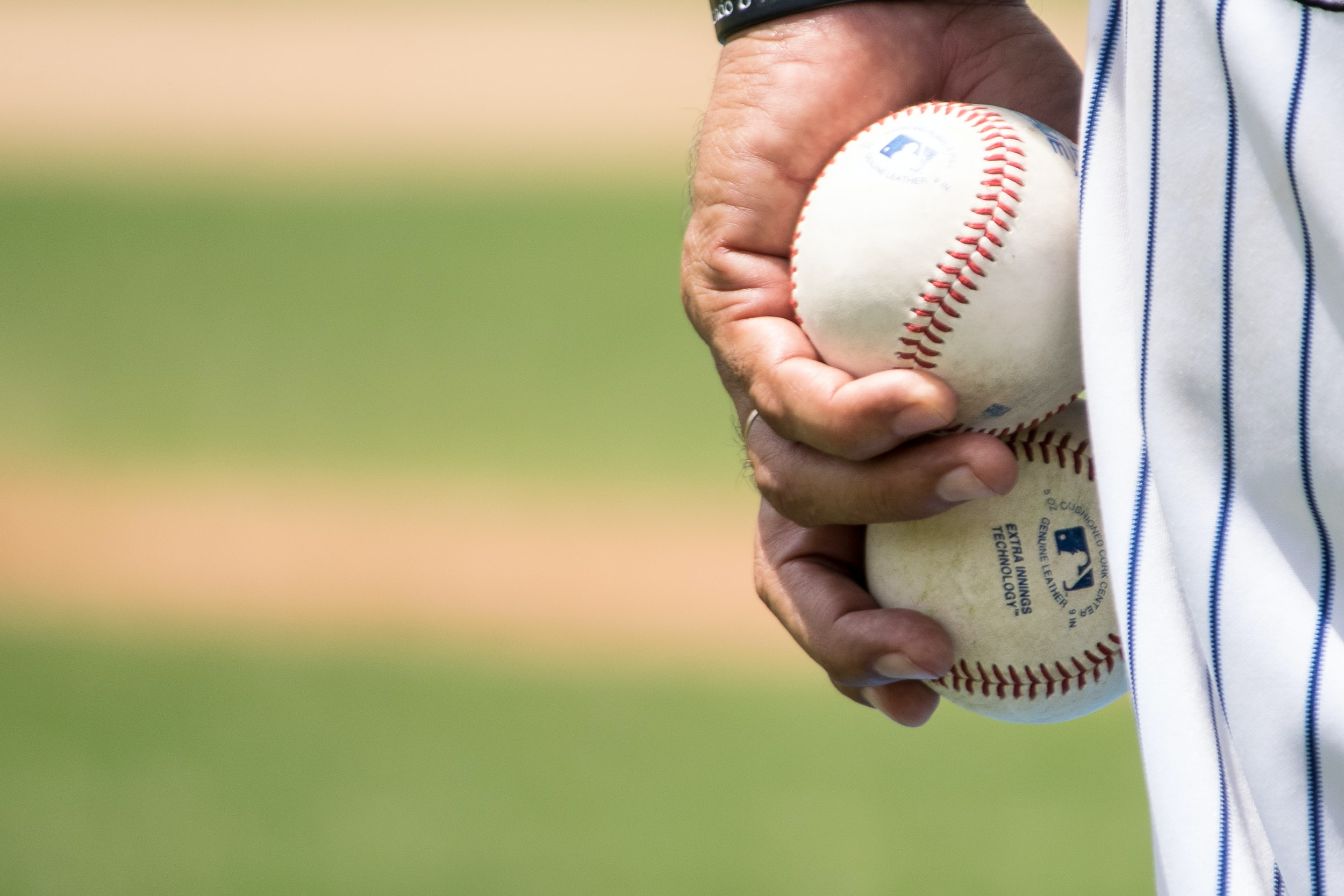 Person holding baseballs